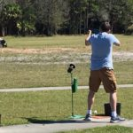 A trap shooter at the clay range, Naples FL