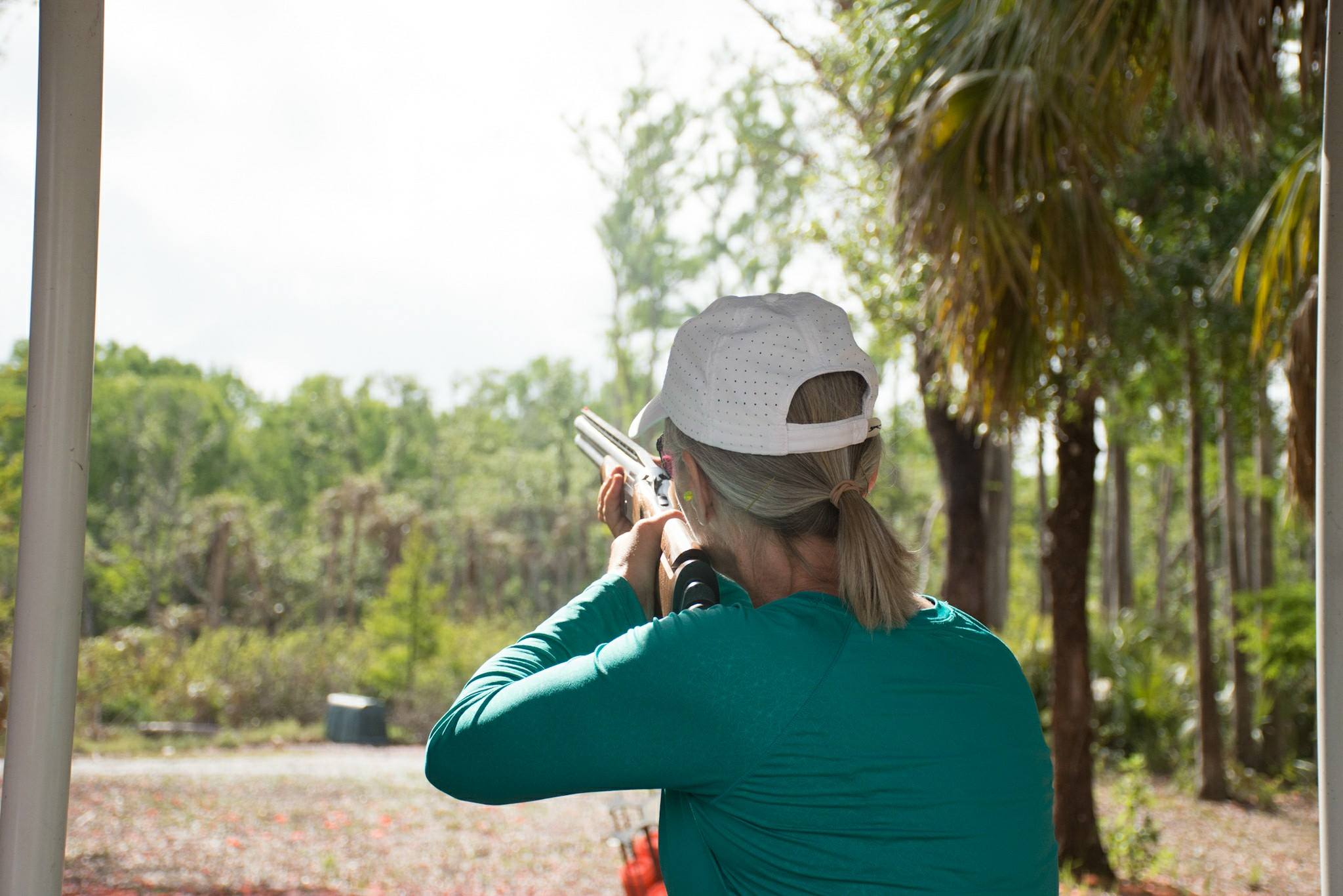 A lady shooting sporting clays