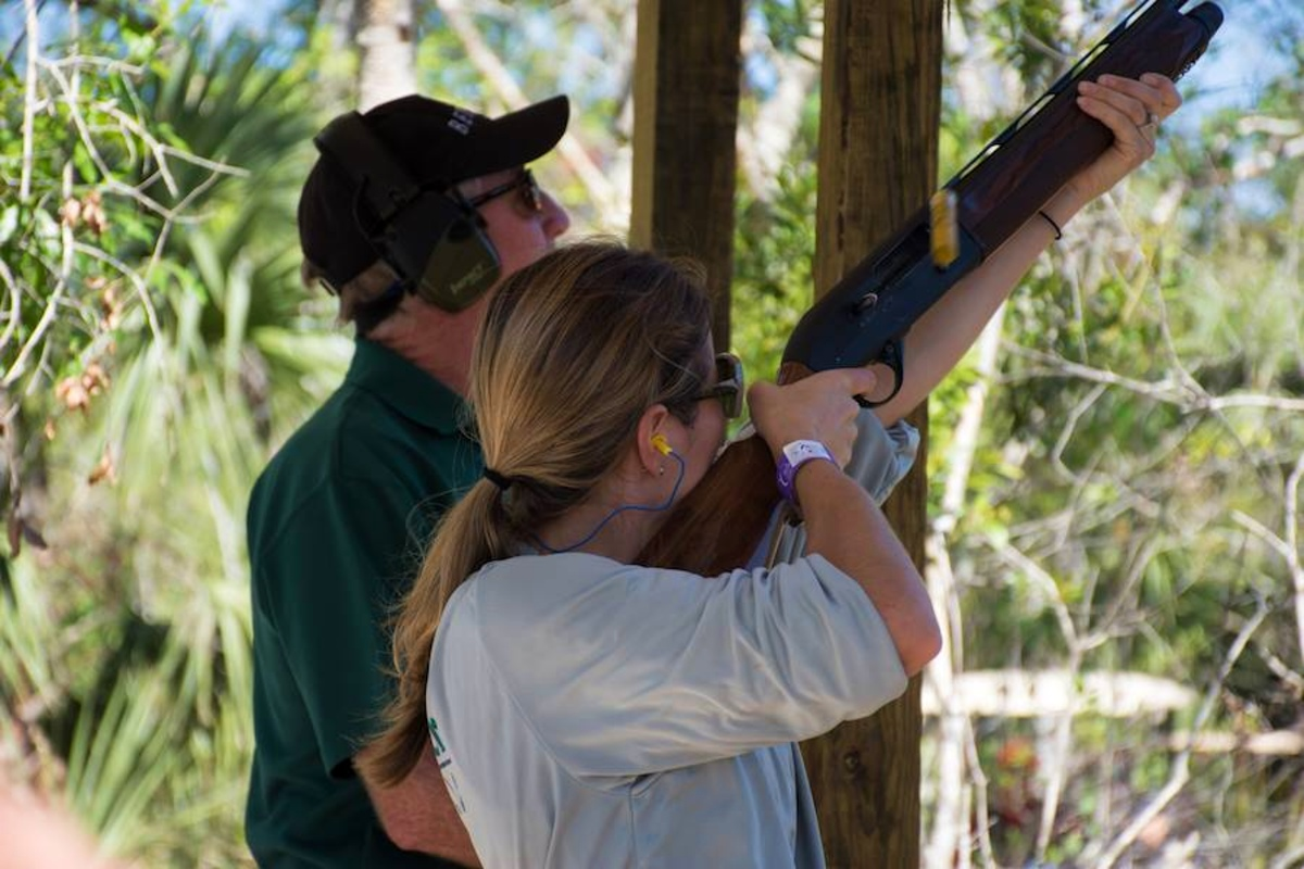 Lady shooting sporting clays