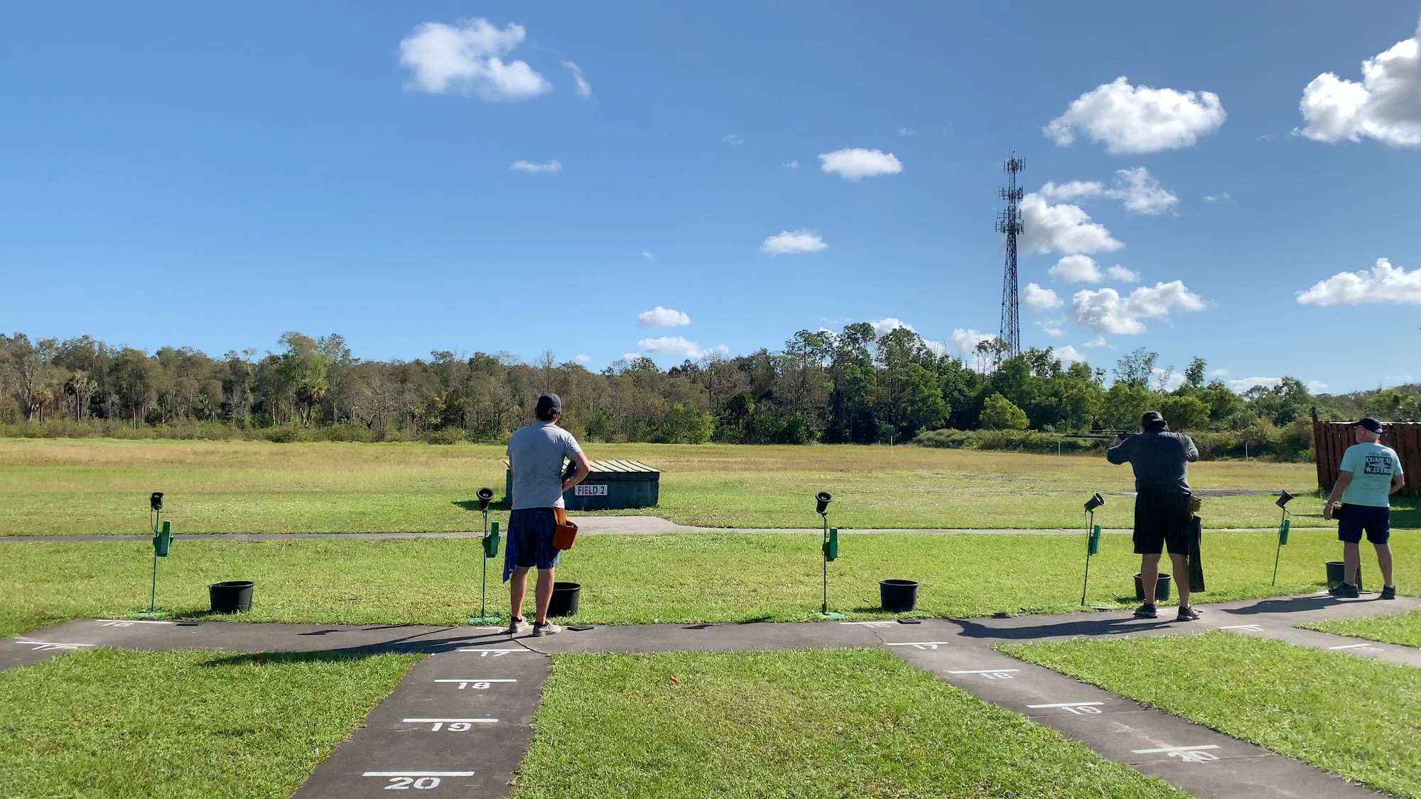 A group of trapshooters on a trap field at Gulf Coast Clays
